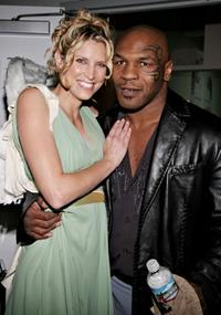 Mike Tyson and a model at the Mercedes-Benz Fashion Week.