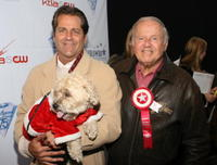 Dick Van Patten and Guest at the 75th Annual Hollywood Christmas Parade.