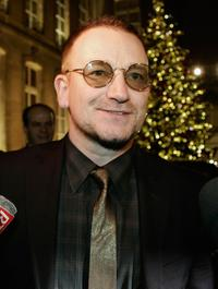 Bono talks at the Elysee Palace after a meeting with French President Nicolas Sarkozy.