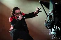 Bono sings onstage in