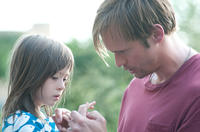Onata Aprile as Maisie and Alexander Skarsgard as Lincoln in