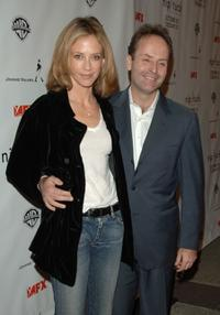 Ally Walker and John Landgraf at the premiere of