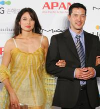 Russell Wong and Guest at the Star Road Red Carpet of 13th Pusan International Film Festival.