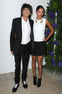 Ronnie Wood and Ana Araujo at the Givenchy Ready to Wear Autumn/Winter 2011/2012 show during the Paris Fashion Week.