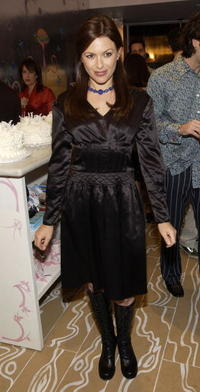Kari Wuhrer at the clothing designer Cynthia Rowley's opening reception.