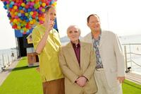 Director Pete Docter, Charles Aznavour and John Lasseter at the premiere of
