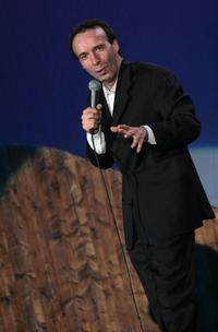 Roberto Benigni performs part of his