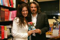 Robby Benson and Joely Fisher talking to an audience and signing copies of his new book