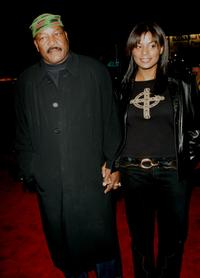 Jim Brown and his wife Nicole at the film premiere of