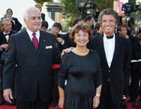 Jean-Claude Brialy, former culture minister Jack Lang and his wife Moniquee at the 56th Cannes film festival.