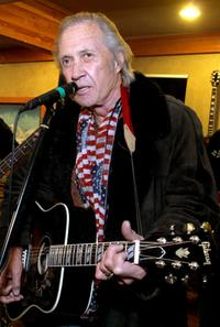 David Carradine performs at the Gibson Guitar and Entertainment Tonight celebrity hospitality lodge in the Miners Club.