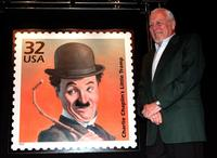 Sydney Chaplin at the replica of the Charlie Chaplin stamp unveiled at the Los Angeles County Museum of Art.