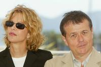 Patrice Chereau and Meg Ryan at the photocall for the jury at the Palais des Festivals during the 56th International Cannes Film Festival.