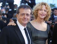 Patrice Chereau and Meg Ryan at the Palais des festivals during the opening ceremony.