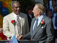 Bill Cosby and Art Linkletter at the podium as they were announced as the Grand Marshalls to lead the 2003 Rose Parade.