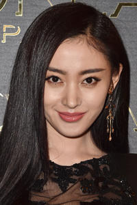 Zhang Tianai at the Gold Obsession Party during Paris Fashion Week.
