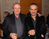 Wes Craven and Olivier Assayas at a cocktail reception before the Los Angeles premiere of