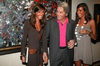 Alain Delon and his guests at the pre-launch cocktail party for his upcoming auction of paintings.