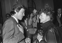 Alain Delon and Katharine Hepburn at the pre-launch cocktail party for his upcoming auction of paintings.
