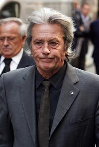 Alain Delon at the church after the funeral of French actor and filmmaker Jean-Claude Brialy.