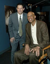 Kareem Abdul-Jabbar and Steve Young attend an exhibit entitled