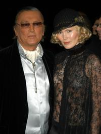 Robert Evans and guest at The Clive Davis Pre-Grammy Party.