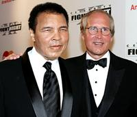 Muhammad Ali and Chevy Chase at an charity event to raise money to battle Parkinson's disease.