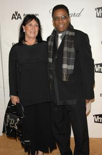 Herbie Hancock and Guest at the 16th Annual Elton John AIDS Foundation Academy Awards viewing party.