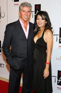 Michael Buffer and Christine Prado at the Tao Nightclub during the club's one-year anniversary party.