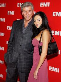 Michael Buffer and guest at the EMI Grammy post party.