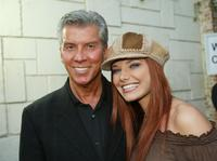 Michael Buffer and Alina at the premiere of
