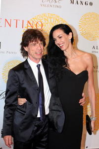 Mick Jagger and L'Wren Scott at the Valentino: 45th Anniversary Celebration.