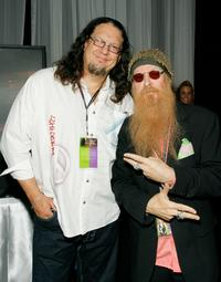Penn Jillette and Billy Gibbons at the Distinctive Assets gift lounge during the Academy of Country Music Awards.