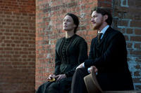 Robin Wright as Mary Surratt and James McAvoy as Frederick Aiken in ``The Conspirator.''