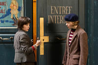 Asa Butterfield as Hugo Cabret and Chloe Moretz as Isabelle in