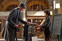 Christopher Lee as Monsieur Labisse and Asa Butterfield as Hugo Cabret in