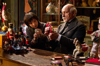 Asa Butterfield as Hugo Cabret and Ben Kingsley as Georges in ``Hugo.''