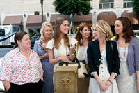 Melissa McCarthy as Megan, Wendi McLendon-Covey as Rita, Rose Byrne as Helen, Ellie Kemper as Becca, Kristen Wiig as Annie and Maya Rudolph as Lillian in ``Bridesmaids.''