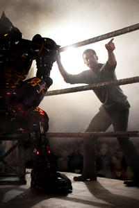 Noisy Boy and Hugh Jackman as Charlie Kenton in ``Real Steel.''
