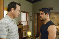 Tom Hanks as Larry Crowne and Wilmer Valderrama as Dell Gordo in ``Larry Crowne.''