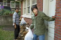 Aziz Ansari as Chet and Jesse Eisenberg as Nick in ``30 Minutes or Less.''