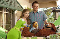 Kermit the Frog, Amy Adams as Mary, Walter, Jason Segel as Gary and Rowlf the Dog in ``The Muppets.''