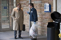 Laurence Fishburne as Dr. Ellis Cheever and John Hines in ``Contagion.''