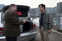 Armin Rohde as Damian Leopold and Chin Han as Sun Feng in ``Contagion.''