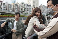 Chin Han as Sun Feng and Marion Cotillard as Dr. Leonora Orantes in ``Contagion.''
