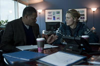 Laurence Fishburne as Dr. Ellis Cheever and Kate Winslet as Dr. Erin Mears in ``Contagion.''