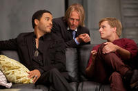 Lenny Kravitz as Cinna, Woody Harrelson as Haymitch Abernathy and Josh Hutcherson as Peeta Mellark in