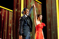 Stanley Tucci as Caesar Flickerman and Jennifer Lawrence as Katniss Everdeen in ``The Hunger Games.''