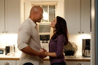 Dwayne Johnson as Hank and Kristin Davis as Liz in ``Journey 2: The Mysterious Island.''