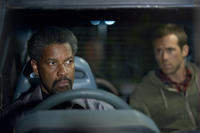 Denzel Washington as Tobin Frost and Ryan Reynolds as Matt Weston in